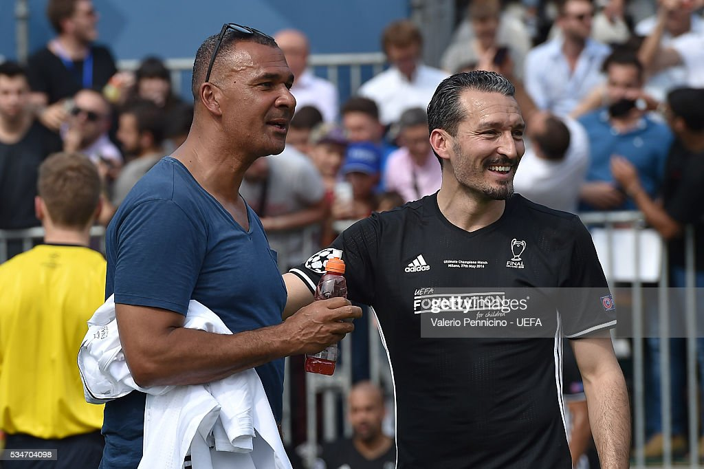 <a gi-track='captionPersonalityLinkClicked' href=/galleries/search?phrase=Ruud+Gullit&family=editorial&specificpeople=2104975 ng-click='$event.stopPropagation()'>Ruud Gullit</a> (L) and <a gi-track='captionPersonalityLinkClicked' href=/galleries/search?phrase=Gianluca+Zambrotta&family=editorial&specificpeople=209127 ng-click='$event.stopPropagation()'>Gianluca Zambrotta</a> of AC Milan & Inter Legends looks on during the Ultimate Champions Match between Milan & Inter Legends and World All-Stars during the Champions Festival prior to the final at Stadio Giuseppe Meazza on May 27, 2016 in Milan, Italy.
