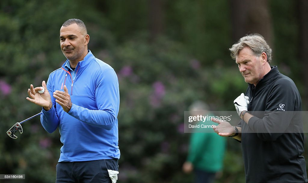 Ruud Gullit and Glenn Hoddle react during the Pro-Am prior to the BMW PGA Championship at Wentworth on May 25, 2016 in Virginia Water, England.