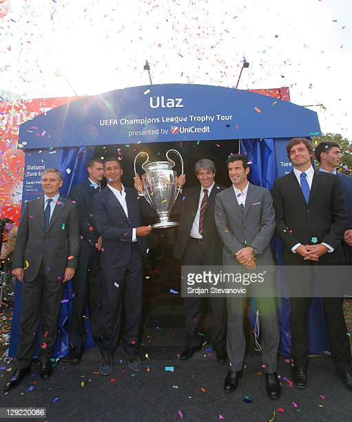 Ruud Gullit and Stevan Stojanovic hold the trophy during opening ceremony of the UEFA Champions League Trophy Tour 2011 on October 14 2011 in...