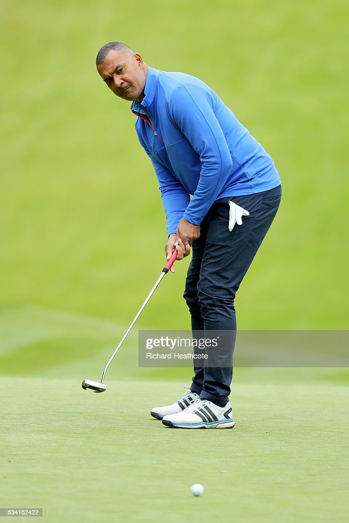 <a gi-track='captionPersonalityLinkClicked' href=/galleries/search?phrase=Ruud+Gullit&family=editorial&specificpeople=2104975 ng-click='$event.stopPropagation()'>Ruud Gullit</a> putts during the Pro-Am prior to the BMW PGA Championship at Wentworth on May 25, 2016 in Virginia Water, England.