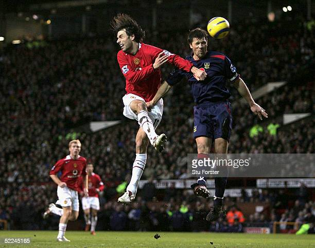 Ruud Van Nistelrooy challenges Arjan De Zeeuw of Portsmouth during the Barclays Premiership match between Manchester United and Portsmouth at Old...