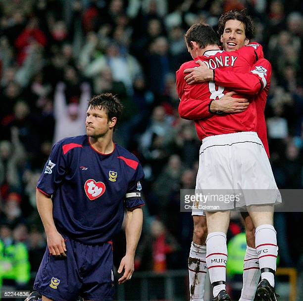 Ruud van Nistelrooy congratulates Wayne Rooney of Manchester United on scoring the first goal during the Barclays Premiership match between...