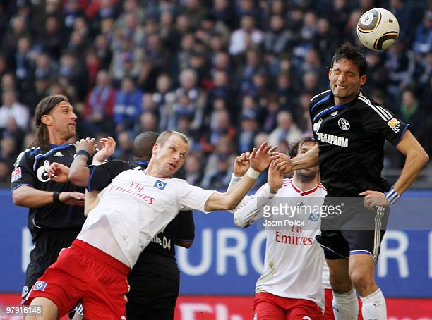 Ruud van Nistelrooy David Rozehnal of Hamburg and Kevin Kuranyi Jefferson Farfan as well as Marcelo Bordon of Schalke compete for the ball during the...