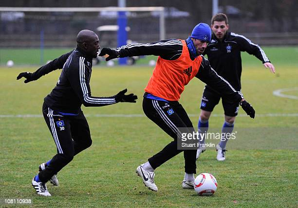 Ruud van Nistelrooy in action with Collin Benjamin during the training session of Hamburger SV on January 18 2011 in Hamburg Germany