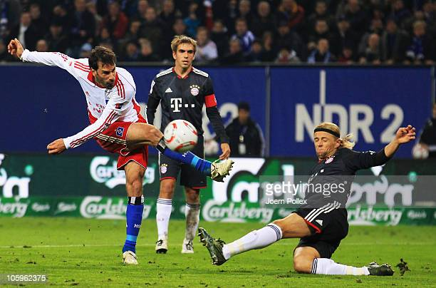 Ruud van Nistelrooy of Hamburg and Anatoliy Tymoshchuk of Bayern battle for the ball during the Bundesliga match between Hamburger SV and FC Bayern...
