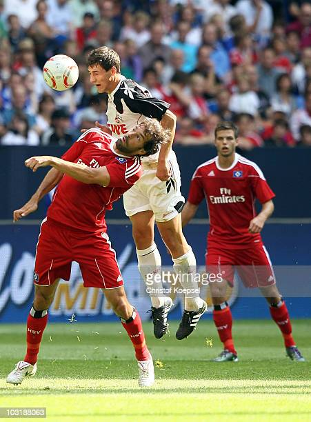 Ruud van Nistelrooy of Hamburg and Mato Jajalo of Koeln go up for a header during the LIGA total Cup 2010 third place playoff match between Hamburger...