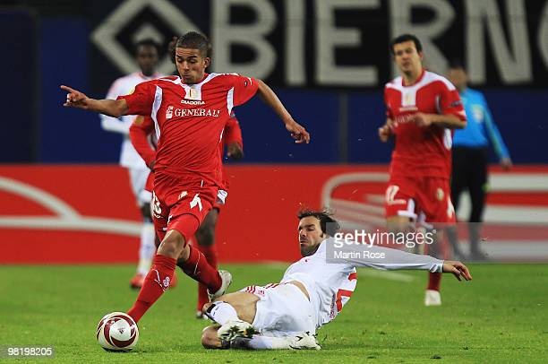 Ruud van Nistelrooy of Hamburg and Mehdi Carcela Gonzalez of Liege battle for the ball during the UEFA Europa League quarter final first leg match...