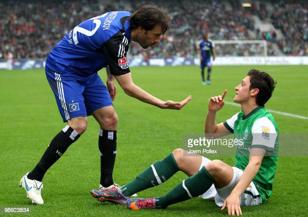 Ruud van Nistelrooy of Hamburg and Mesut Oezil of Bremen speak during the Bundesliga match between SV Werder Bremen and Hamburger SV at Weser Stadium...