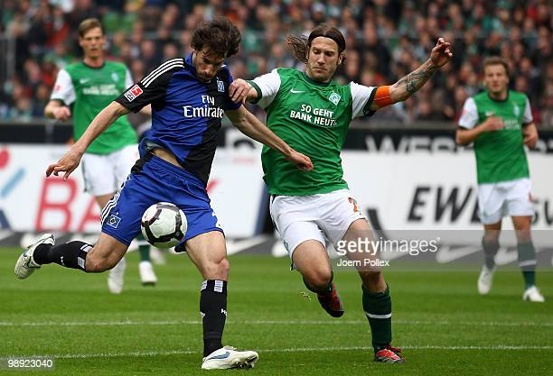Ruud van Nistelrooy of Hamburg and Torsten Frings of Bremen battle for the ball during the Bundesliga match between SV Werder Bremen and Hamburger SV...