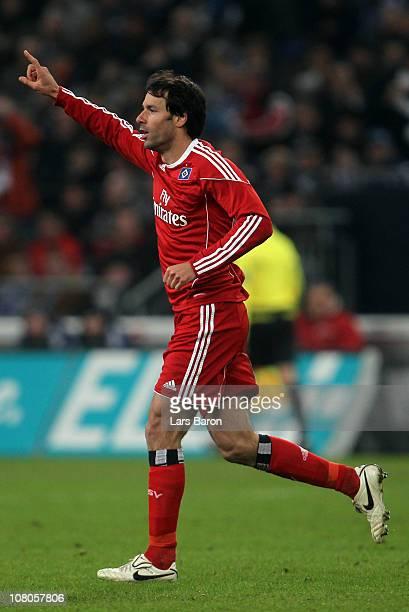 Ruud van Nistelrooy of Hamburg celebrates after scoring his teams first goal during the Bundesliga match between FC Schalke 04 and Hamburger SV at...