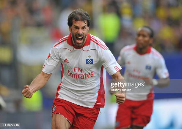 Ruud Van Nistelrooy of Hamburg celebrates scoring his goal during the Bundesliga match between Hamburger SV vandBorussia Dortmund at the Imtech Arena...