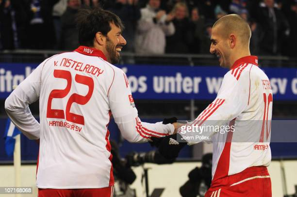 Ruud van Nistelrooy of Hamburg celebrates with his team mate Mladen Petric after scoring his team's fourth goal during the Bundesliga match between...