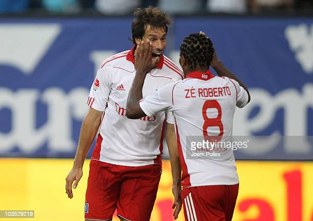 Ruud van Nistelrooy of Hamburg celebrates with his team mate Ze Roberto after scoring his team's second goal during the Bundesliga match between...