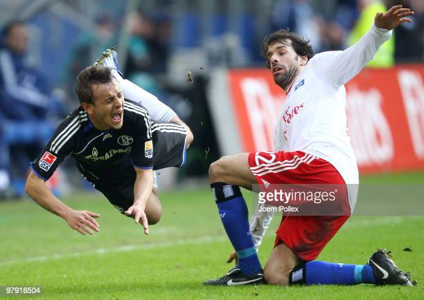 Ruud van Nistelrooy of Hamburg challanges Rafinha of Schalke during the Bundesliga match between Hamburger SV and FC Schalke 04 at HSH Nordbank Arena...
