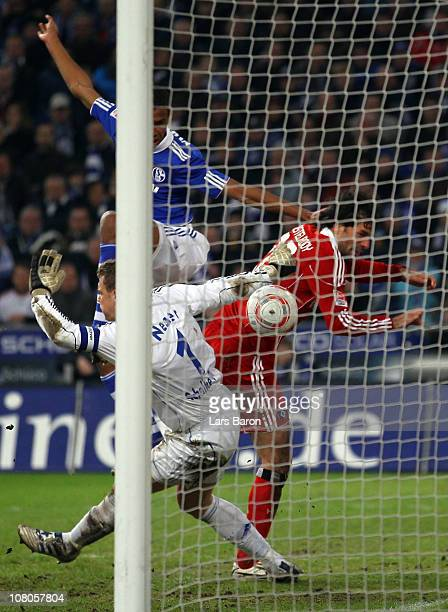 Ruud van Nistelrooy of Hamburg heads his teams first goal past Marvin Matip and goalkeeper Manuel Neuer of Schalke during the Bundesliga match...