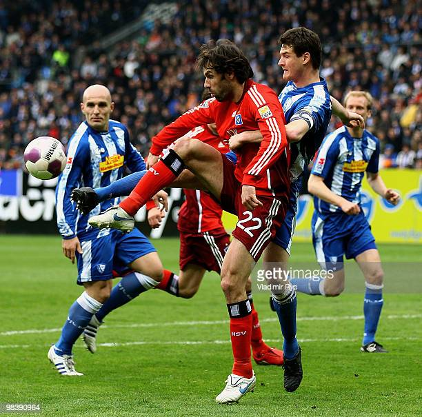 Ruud van Nistelrooy of Hamburg is covered by Marcel Maltritz of Bochum during the Bundesliga match between VfL Bochum and Hamburger SV at Rewirpower...