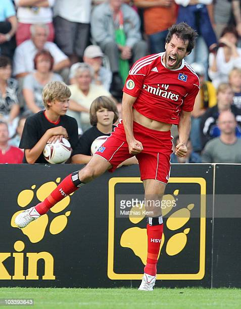 Ruud van Nistelrooy of Hamburg jubilates after scoring the fourth goal during the DFB Cup first round match between Torgelower SV Greif and Hamburger...