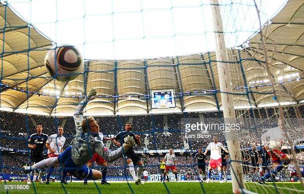 Ruud van Nistelrooy of Hamburg scores his team's first goal against goalkeeper Manuel Neuer of Schalke during the Bundesliga match between Hamburger...