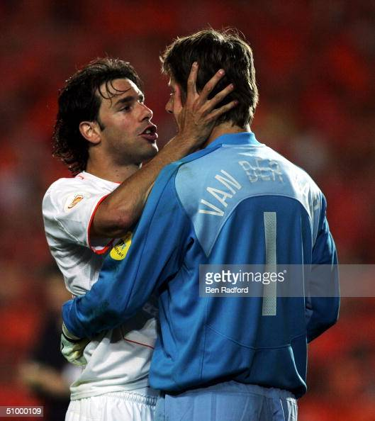 Ruud Van Nistelrooy of Holland tries to encourage goalkeeper Edwin Van Der Sar during the UEFA Euro 2004 Quarter Final match between Sweden and...