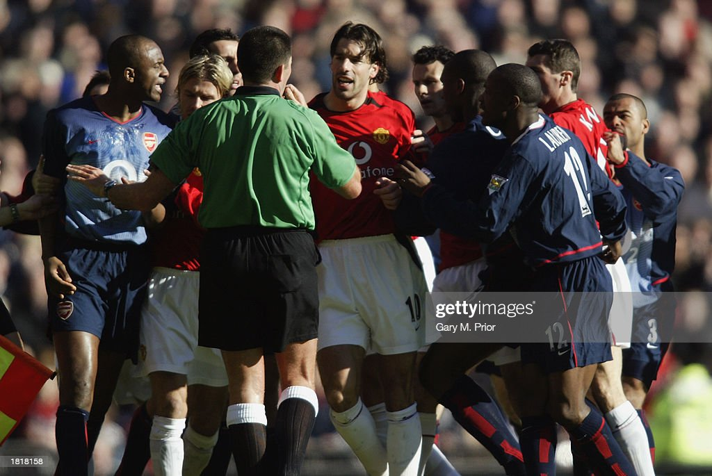 Ruud van Nistelrooy of Manchester United argues with the referee Jeff Winter as a brawl breaks out during the FA Cup fifth round match between Manchester United and Arsenal held on February 15, 2003 at Old Trafford, in Manchester, England. Arsenal won the match 2-0.