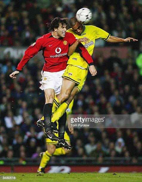 Ruud van Nistelrooy of Manchester United clashes in the air with Jon Fortune of Charlton Athletic during the FA Barclaycard Premiership match between...