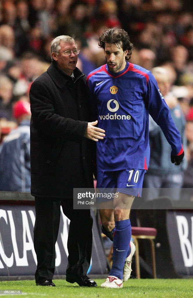 Ruud Van Nistelrooy (R) of Manchester United is congratulated by his manager Sir Alex Ferguson after being substituted during the Barclays Premiership match between Charlton Athletic and Manchester United at The Valley on November 19, 2005 in London, England.