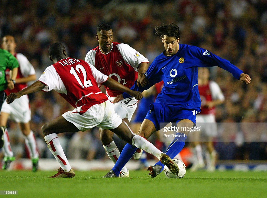 Ruud Van Nistelrooy of Manchester United is tackled by Lauren of Arsenal during the FA Barclaycard Premiership match between Arsenal and Manchester United held on April 16, 2003 at Highbury in London, England. The match ended in a 2-2 draw.
