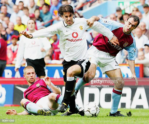 Ruud van Nistelrooy of Manchester United keeps the ball away from Thomas Hitzelsperger and Gavin McCann of Aston Villa during the FA Barclaycard...