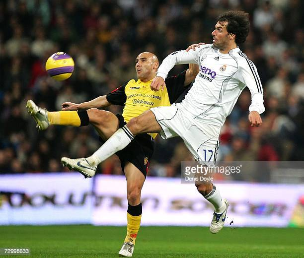Ruud van Nistelrooy of Real Madrid goes for the ball with Jose Movilla of Zaragoza during the La Liga match between Real Madrid and Real Zaragoza at...