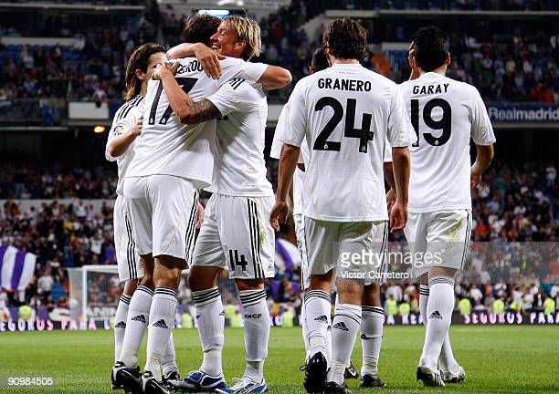Ruud Van Nistelrooy of Real Madrid is congratulated after scoring the 50 goal by team mate Guti Esteban Granero and Ezequiel Garay during the La Liga...