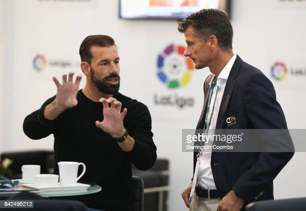 Ruud van Nistelrooy of the Netherlands and Wim Jonk Cruyff Football CEO talk during day 1 of the Soccerex Global Convention at Manchester Central...
