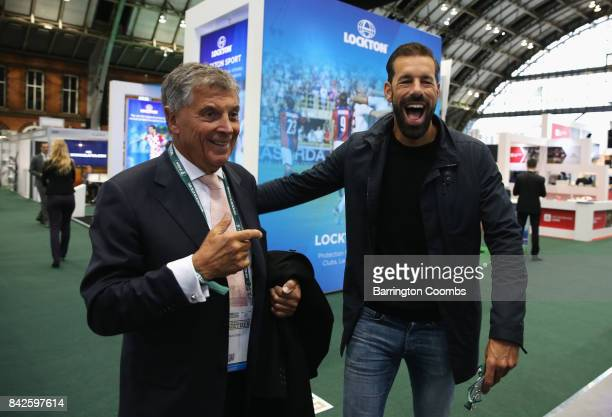 Ruud van Nistelrooy of the Netherlands laughs with David Dein The FA former ViceChairman during day 1 of the Soccerex Global Convention at Manchester...