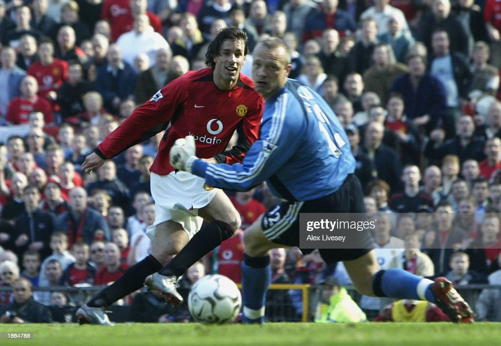 Ruud Van Nistelrooy of United gets past Maik Taylor of Fulham to score during the FA Barclaycard Premiership match between Manchester United and...