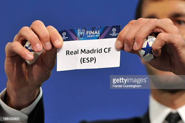 Ruud van Nistelrooy shows the name Real Madrid CF during the UEFA Champions League semifinal draw at the UEFA headquarters on April 12 2013 in Nyon...