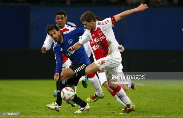 Ruud van Nistelroy of Hamburg and Jan Vertonghen of Amsterdam battle for the ball during the friendly match between Hamburger SV and Ajax Amsterdam...