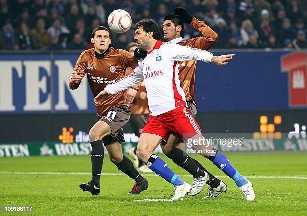 Ruud van Nistelroy of Hamburg and Ralph Gunesch and Carlos Zambrano of StPauli battle for the ball during the Bundesliga match between Hamburger SV...