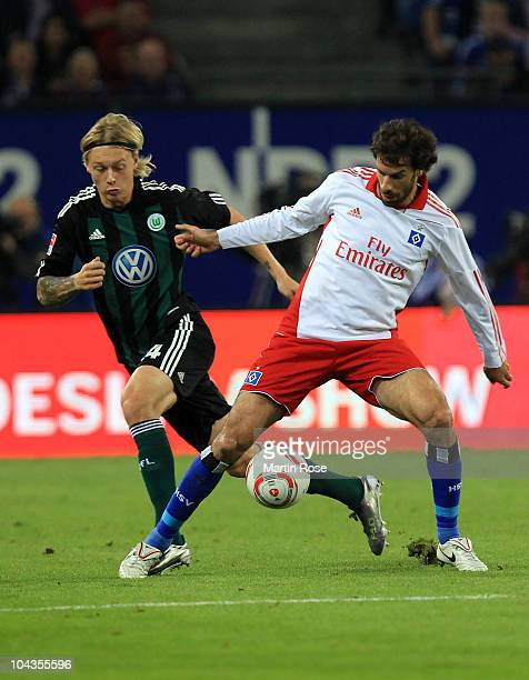 Ruud van Nistelroy of Hamburg and Simon Kjaer of Wolfsburg battle for the ball during the Bundesliga match between Hamburger SV and VFL Wolfsburg at...