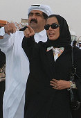 Qatar's Emir Sheikh Hamad bin Khalifa alThani and his wife Sheikha Moza bint Nasser alMisnad attend a ceremony for lighting the 15th Asian Games...