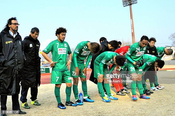 Ruy Ramos and FC Gifu players applaud the travelling supporters after their team's 04 defeat in the JLeague second division match between Thespa...