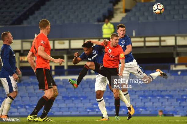 MFK Ruzomberok's Peter Maslo vies with Everton's Frenchborn Congolese midfielder Yannick Bolasie and Everton's English defender Michael Keane during...