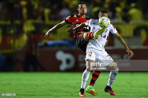 Rver of Flamengo struggles for the ball with Richarlison of Fluminense during a match between Fluminense and Flamengo as part of Brasileirao Series A...