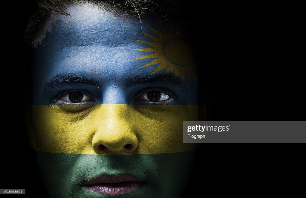 Rwanda flag on face : Stock Photo