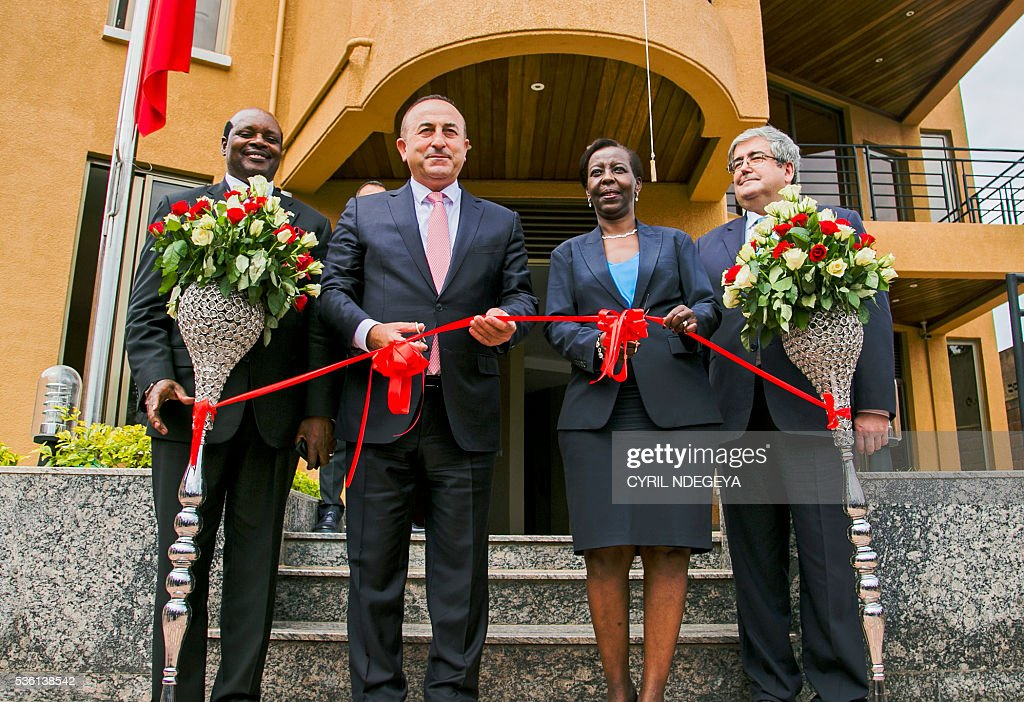 Rwandan Ambassador to Turkey Hon William Nkurunziza, Turkish Minister for Foreign Affairs Mevlut Cavusoglu, Rwandan Minister for Foreign Affairs Louise Mushikiwabo and Turkish Ambassador to Rwanda Mehmet Raif Karaca cut the ribbon to innaugurate the new Turkish embassy in Kigali on May 31, 2016. Rwanda-Turkey agreements are expected to strengthen economic ties between the two countries through trade promotion, co-ordination, as well as information, skills and knowledge sharing. Cavusoglu also officially opened the new Turkish embassy in Kigali. / AFP / CYRIL