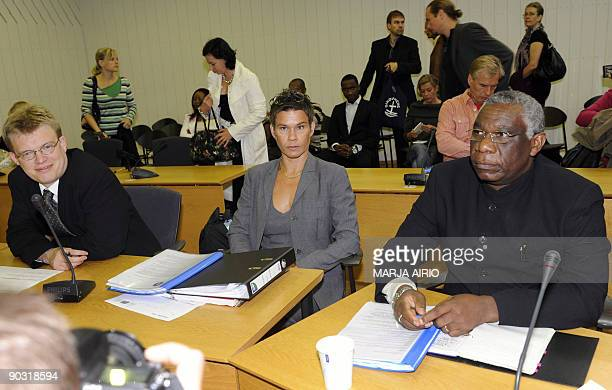 Rwandan Bazaramba Francois and his lawyers Ville Hoikkala and Ingrid Heickell in local court in Porvoo in southern Finland on Sebtember 3 2009...
