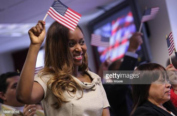 Rwandan immigrant and genocide survivor Immaculee Ilibagiza celebrates after taking the oath of American citizenship at a naturalization ceremony on...