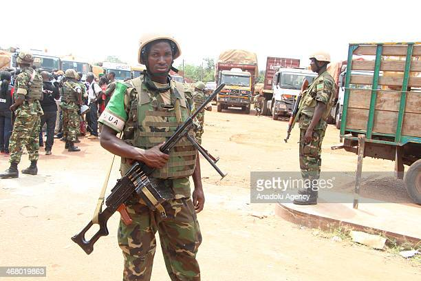 Rwandan peacekeeper guards a venue where trucks carrying food and other essentials arrived from Cameroon on February 8 2014 in Bangui Central African...