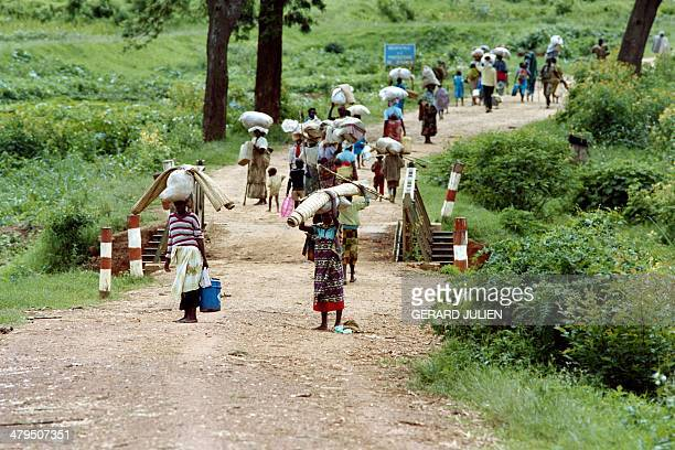 Rwandan refugees walk on the Byumba road as they flee from Kigali on May 11 1994 Rwanda's civil war continues after the death of Hutu president...