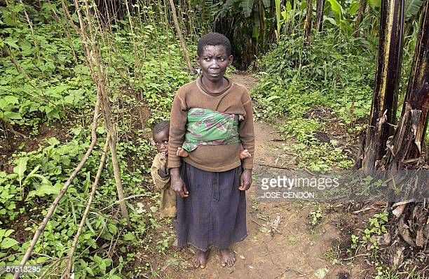 Rwandan twa pigmy woman poses with her son in the village of Bweyeye southwestern Rwanda 22 April 2006 Twa pygmies in this remote part of southern...