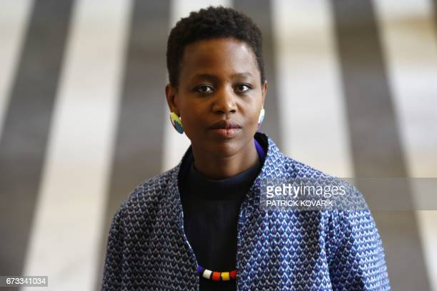 Rwandanborn British choreographer Dorothée Munyaneza poses during a photo session on April 26 2017 in Paris / AFP PHOTO / PATRICK KOVARIK