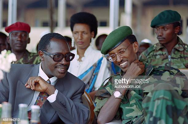 Rwanda's new elected Hutu President Pasteur Bizimungu and his vice President Paul Kagame the Tutsiled RPF commander share a joke in Kigali on July 19...